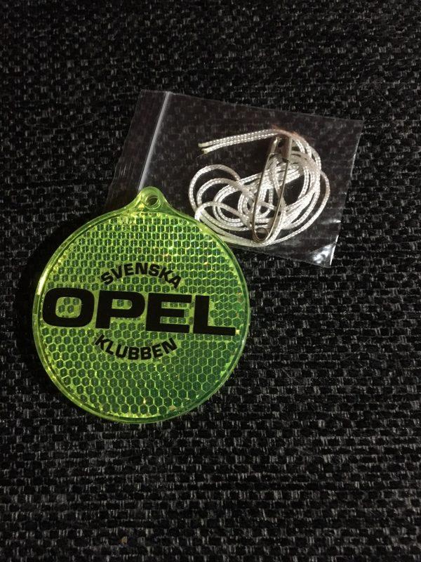 Reflex med Svenska Opelklubbens logga